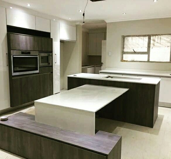 High gloss with wood. Quartz counter  tops.