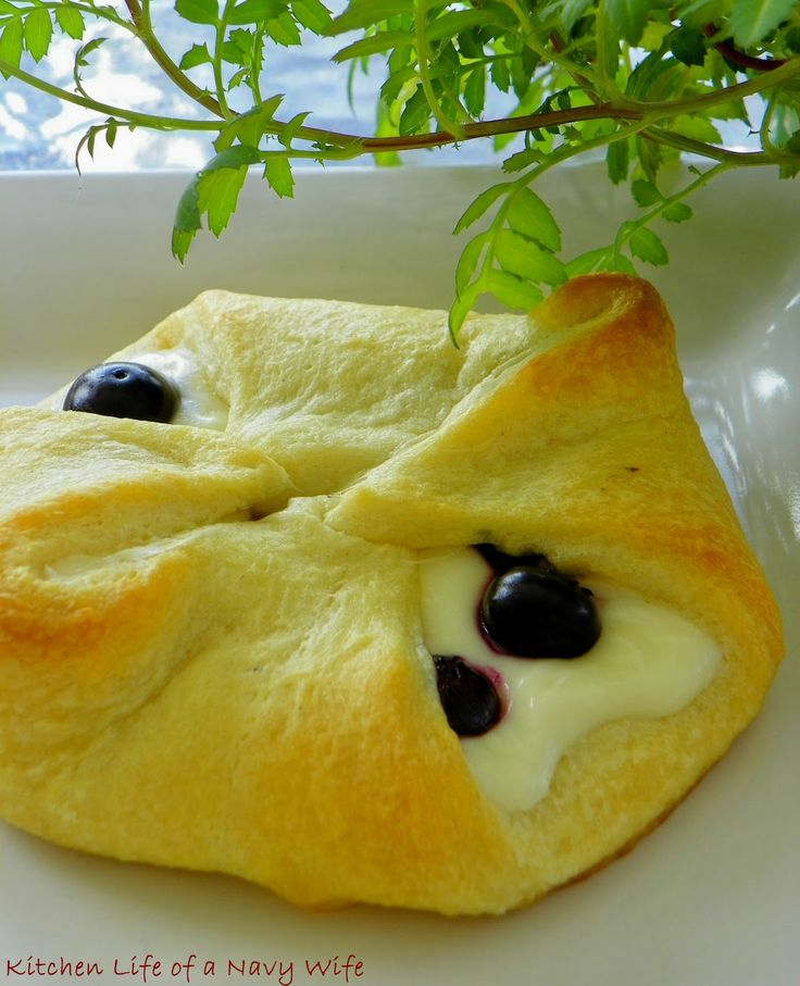 Blueberry Cream Cheese Rolls....mix 4 oz of softened cream cheese with 2 Tbsp of sugar, spread on rectangle sectioned crescent roll, top with blueberries.  Fold dough corners up & pinch.  Bake on ungreased sheet at 375 for 11 minutes.
