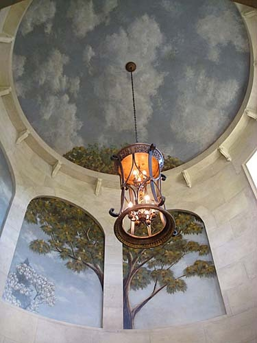 trompe l'oeil~ like the tree top showing thru at top of dome
