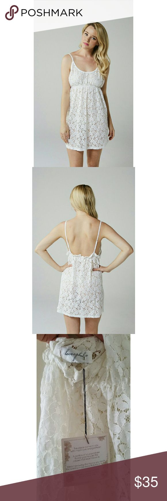 Love Ophelia Scarlett Lace Nightie Feminine flowers trail along this soft and sheer antique white silhouette. Scoops gently across the back. Makes for a sultry honeymoon set when paired with lace robe.  Made in the USA  Floral lace in cotton  Adjustable straps  Hand wash Love Ophelia Intimates & Sleepwear Chemises & Slips