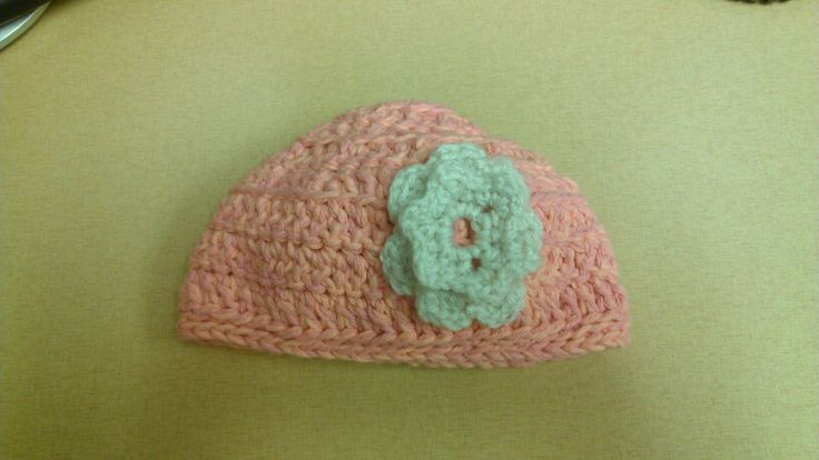 Baby crocheted hat with flower