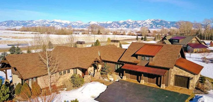 Stunning #BozemanLuxuryHomes - Impressive, 1-acre #BozemanLuxuryRealEstate offering. Chef's kitchen with Pro appliances, custom cabinetry. Open, yet separate spaces, fostering entertaining! Covered, outdoor patio with stone fireplace, cascading rock waterfall. Extensive landscaping/trees and mountain views. Luxury, main floor master suite with fireplace, custom closet, spacious bathroom. In-floor radiant heat, AC, security system; surround sound; heated, 3 car garage. #TaunyaFagan