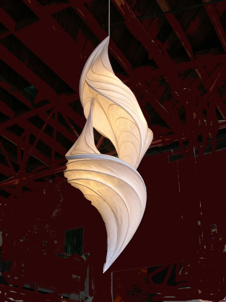It looks like boning has been used for structure of the swirls. You can see the pattern in the curved lines. <3 paper light sculptures by William Leslie.