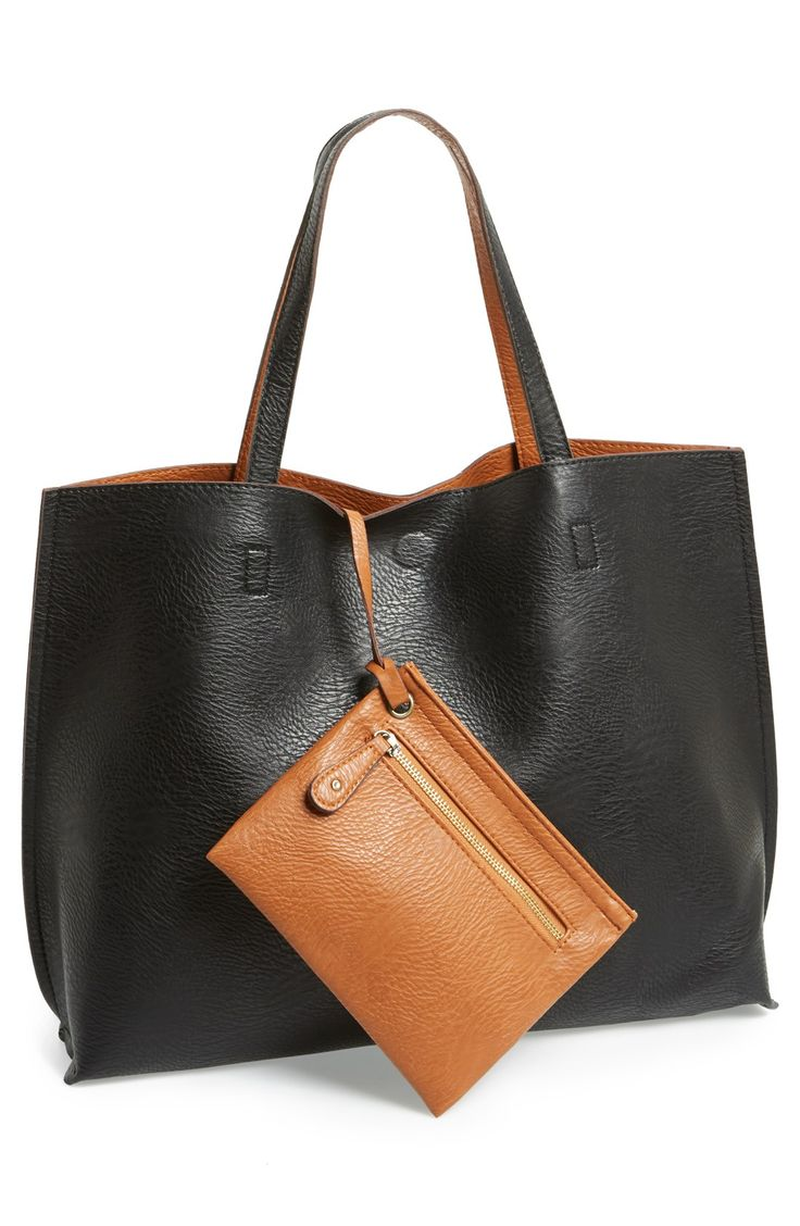 This reversible leather tote with matching wristlet is so versatile. It's the perfect bag for storing the essentials when on-the-go.