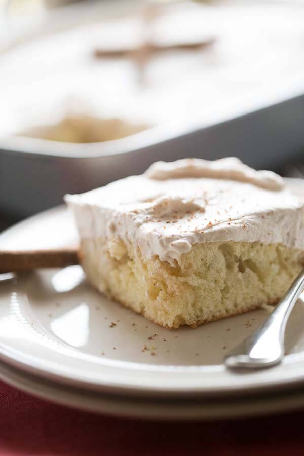 Snickerdoodle Poke Cake-Featured recipe at Weekend Potluck from Lemons for Lulu. Who doesn't love a good snickerdoodle?  All the favorite cookie flavor in a wonderful cake. www.thecountrycook.net