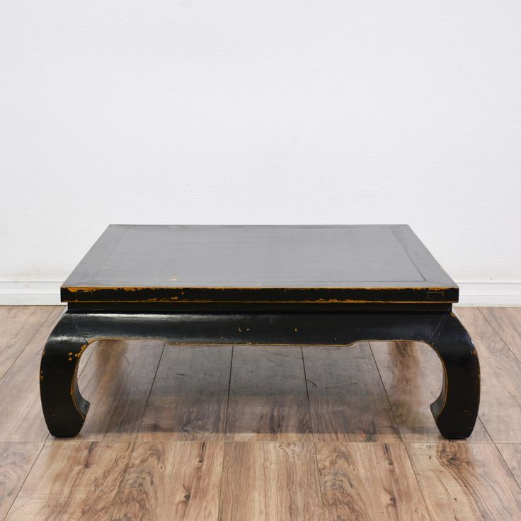 This Asian-style coffee table is featured in a solid wood with a lightly distressed black finish. This Ming-style table has a square table top, quadrangular legs and horseshoe feet. Would complement any contemporary-style furniture! #asian #tables #coffeetable #sandiegovintage #vintagefurniture
