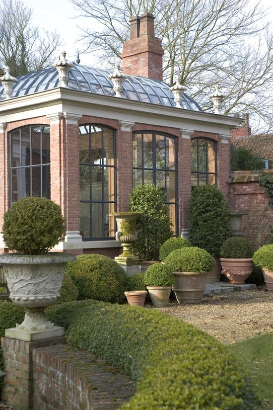 Modern Country conservatory plus boxwood alls and topiary!