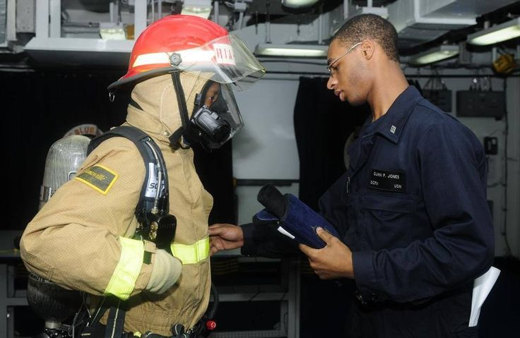 Master Chief Petty Officer of the Navy (MCPON)(AW/NAC) Michael D. Stevens...... Zeroing in on Excellence: Developing Leaders KOREA STRAIT (Aug. 10, 2014) Midshipman Theodore Miller, left, and Damage Controlman Fireman Quinn Jones, demonstrate how to properly don firefighting equipment aboard the U.S. 7th Fleet flagship USS Blue Ridge (LCC 19). U.S. Navy photo by MC3 Jacob Waldrop/Released