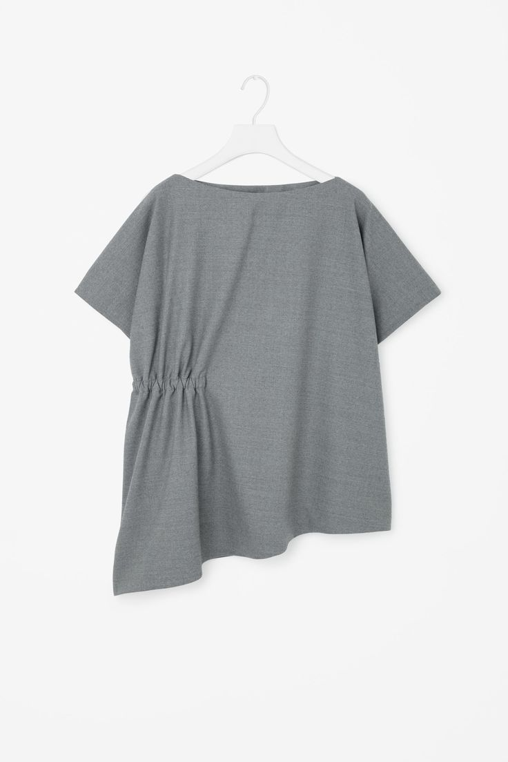 This top is made from soft, unlined wool-mix with an elasticated gathered detail on one side. Wide-cut for a loose, slightly oversized fit, it has a wide round neckline and cap kimono sleeves.