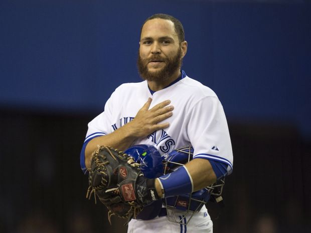 Russell Martin has come home to Canada.  Now in his first season with the Toronto Blue Jays, he is shown here at an exhibition game in his home town of Montreal where his father played the national anthems on his saxophone.  The Jays lost to the Reds, 2-0.  Joey Votto from Toronto played first for the Reds.  They still love baseball in Montreal.