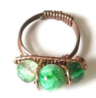 Simple copper wire Roman style ring set with glass beads.
