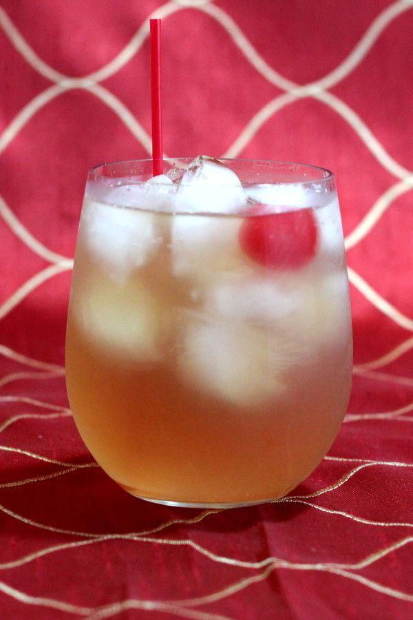 Amaretto Sour drink recipe, a classic cocktail with amaretto, lemon juice, sugar and a cherry. http://mixthatdrink.com/amaretto-sour/