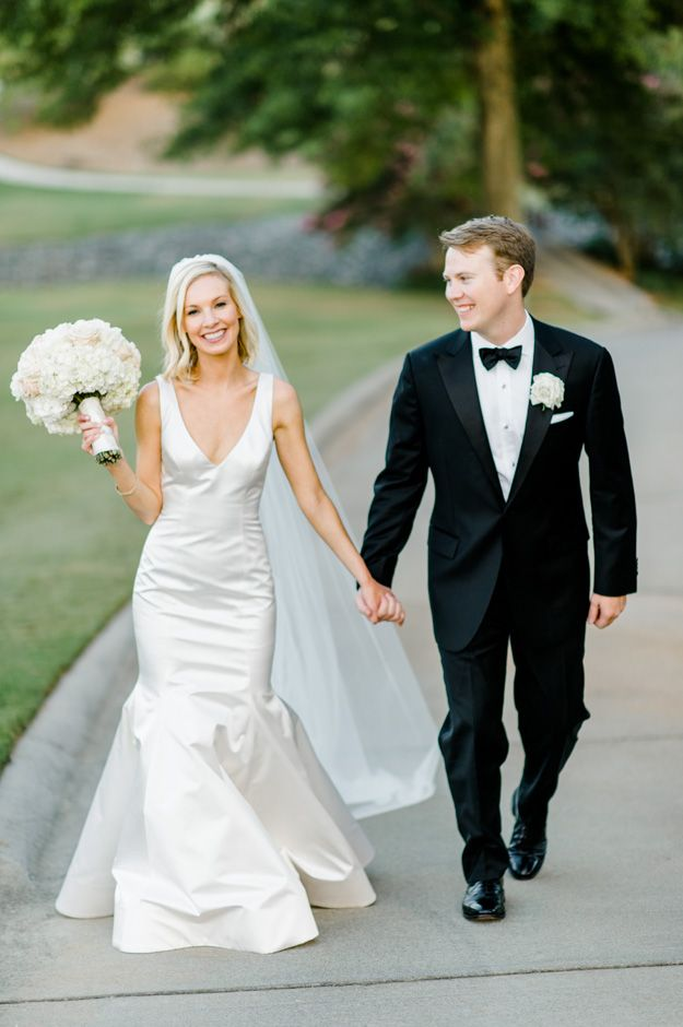 Bride and groom's portraits. Monique Lhuillier custom wedding gown.