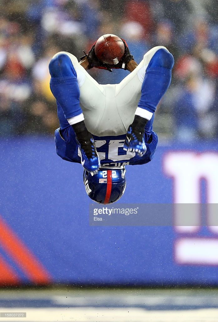 David Wilson #22 of the New York Giants celebrates his third touchdown of the game against the New Orleans Saints on December 9, 2012 at MetLife Stadium in East Rutherford, New Jersey.