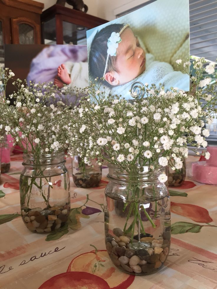 Centerpieces for baby girl's baptism reception: mason jar, rocks, photo holder, baby's breath