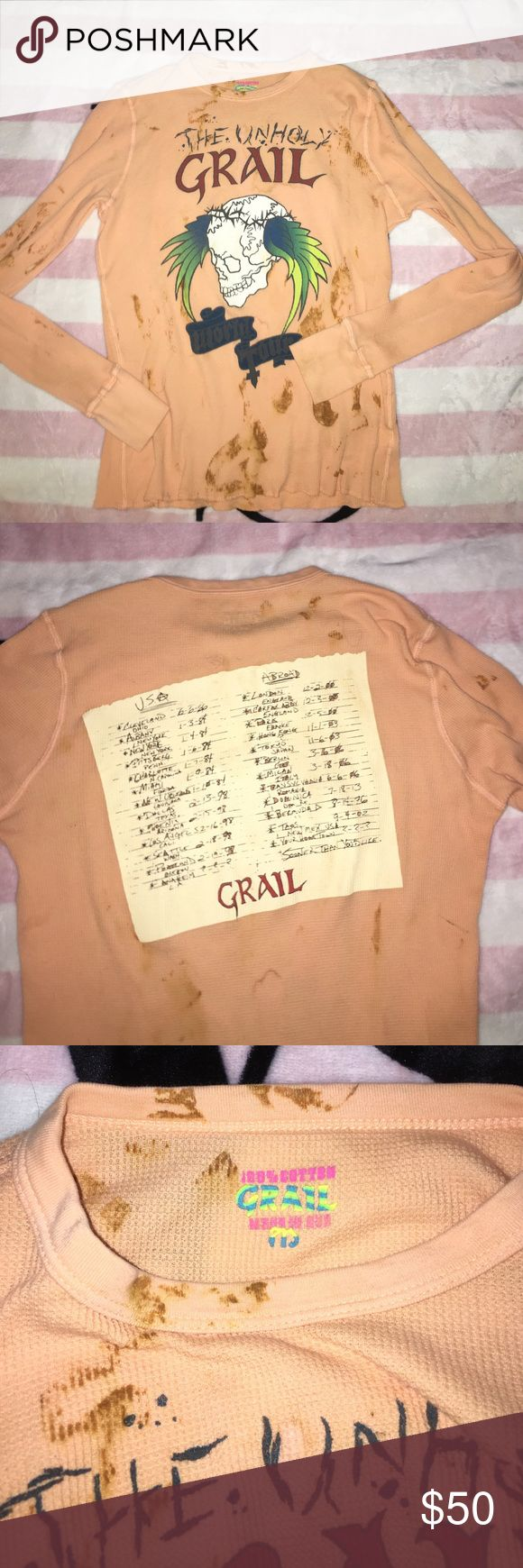 NWOT Grail Concert Tour Thermal Unholy Grail Thermal in a light orange/peach color. Very long sleeves with thumb holes to wear over your hands. Very long in length going way past pant line. A skull with wings on front and concert tour list on the back. No rips or stains. No fading or signs of ware. Size Medium but can fit a Small with an oversized look or Large for a fitted look Grail Tops Tees - Long Sleeve