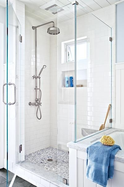 Pebble floor tile with grey tones, plus white shower walls