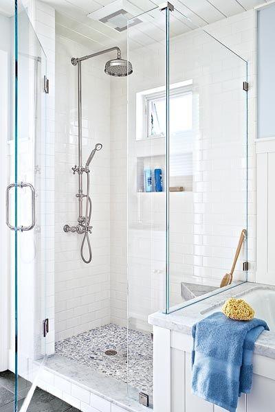 Pebble floor tile with grey tones, plus white shower walls