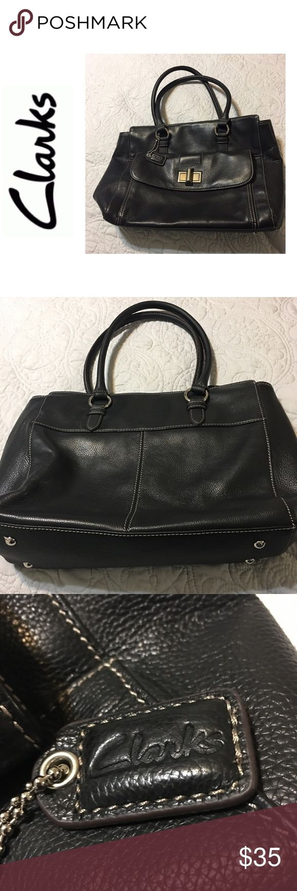 Clarks Large Leather Tote Genuine Leather  Large Tote 4 feet at bottom of bag 2 rolled leather handles One Large Flap pocket on front of bag Inside 1 zipper and 2 slip pockets  Silver accents H 10 x W 16 x D 4 Drop 8.                              Price is Negotiable Clarks Bags Totes