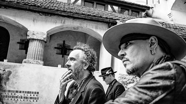#TimBurton and #JohnnyDepp listen to some of the history of #BranCastle, aka #Dracula's #Castle.  Photo by @cerealkyler ---------------------------------------------------- #Transylvania #hollywoodvampires #europe #tour #travel #concert #candid #blackandwhite #romania