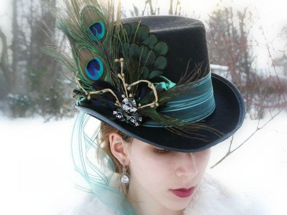 This Mad Hatter top hat, neo gothic top hat neo victorian top hat, Alice in wonderland top hat, steampunk top hat, derby black top hat features one black hat base (sourced), one generous length of ribbon made of silky organza , and a handmade by me oversized applique.    ATTENTION BUYERS: For your convenience, here are the shipping fees for this item:  Canada: $ 20 (or $12 with another item) US: $12 (or $10 with another item) Everywhere else: $35 (or $30 with another item   The applique…