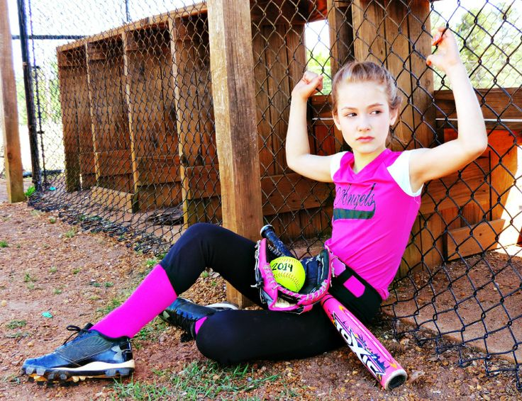 Girls softball picture against dugout
