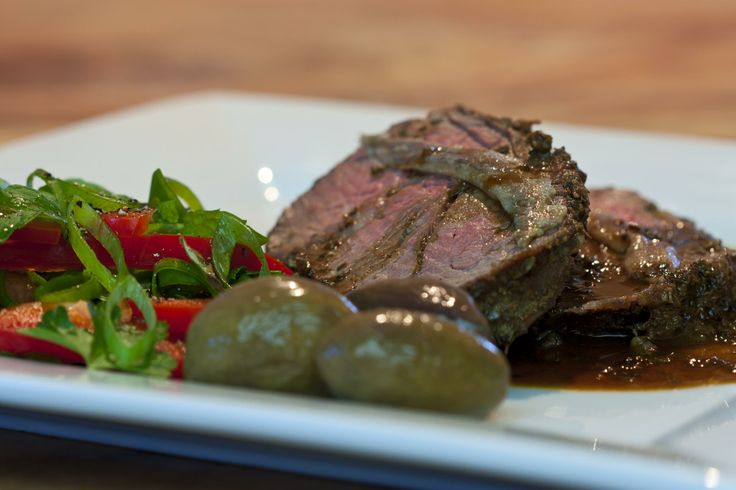 This is tonight's dinner. Mediterranean style, eye fillet encrusted in a mix of spices and oregano. Roasted medium rare, with a jus reduction, topped with anchovies, served with a side or herbs, home pickled olives in red wine vinegar and olive oil.