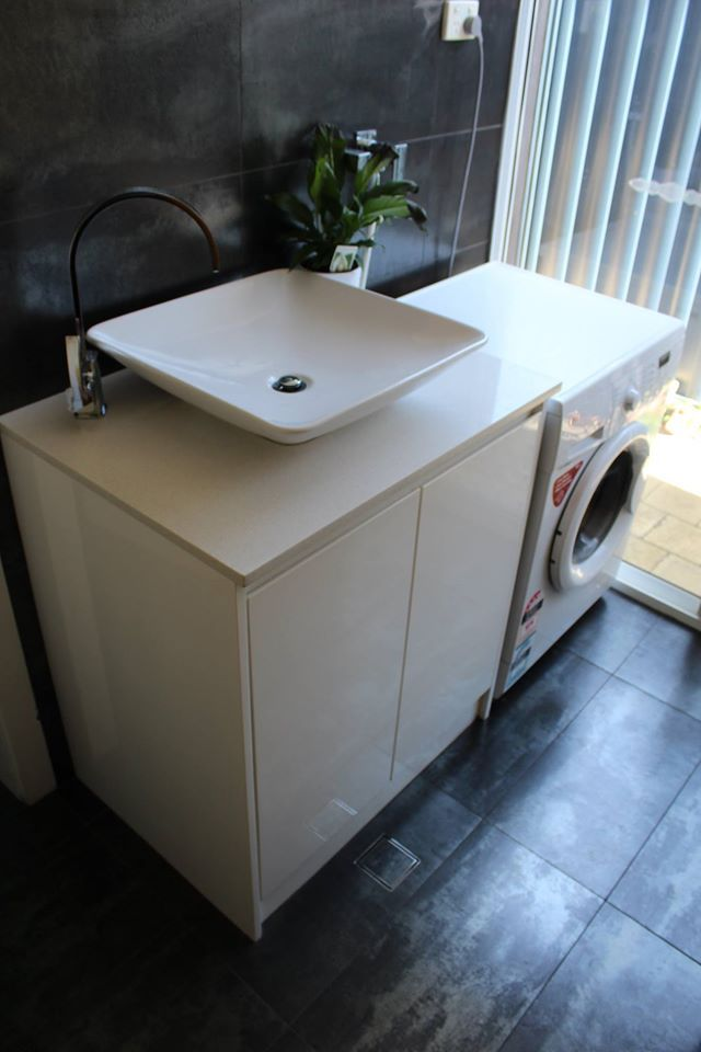 Ambrose Gloss White Cupboard With Ice White Stone Top.  Laundry Idea - Laundry Tops - Laundry Cupboards - Laundry Ideas - Laundry Sink - Laundries - Laundry Renovation - On the ball bathroom completed project   Laundry Perth    Bathroom Renovations Maylands