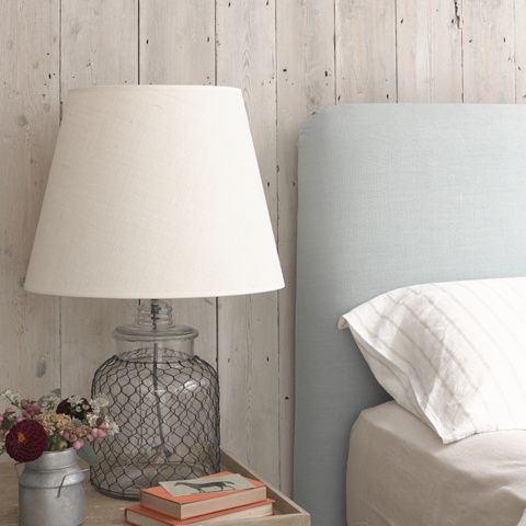 Cluck glass lamp on bedside table
