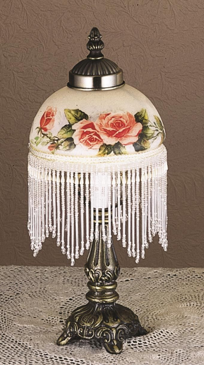 "13.5 Inch H Rosebush Fringed Mini Lamp - 13.5 Inch H Rosebush Fringed Mini LampHand painted Apricot Roses adorn this charming fringedglass shade which is matched with a Mahogany Bronze finished lamp base. The Rose mini lamp is a romanticway to add light to your room. Theme: VICTORIAN FRINGE Product Family: Rosebush Product Type: NOVELTY LAMPS AND ACCESSORIES Product Application: Color: Bulb Type: CNDL Bulb Quantity: 1 Bulb Wattage: 40WT Product Dimensions: 13.5""H x 6WPackage Dimensions…"