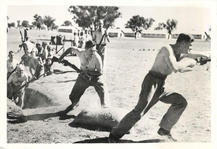 1942- Australian soldiers shown during drill as they train with bayonets.