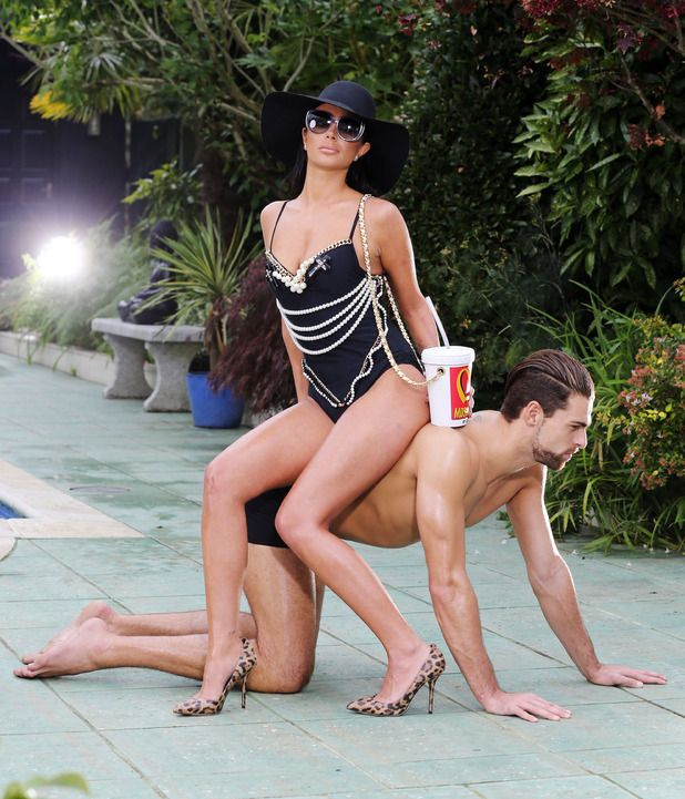 Tulisa Contostavlos uses a man as a chair and reclines in pearl-embellished swimwear and leopard-print stilettos in her new music video. The 'Young' singer has shared pictures from the upcoming visuals to her comeback single 'Living Without You'. Follow us: @digitalspy on Twitter | digitalspyuk on Facebook