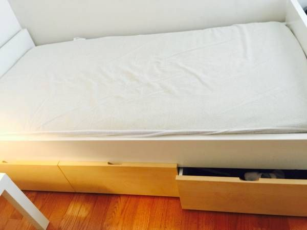 ikea twin bed with mattress side table lamp