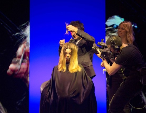 Our Global Artistic Director and 3-time British Hairdresser of the Year, Angelo Seminara, on stage at Cosmoprof 2013! Doing what he does...