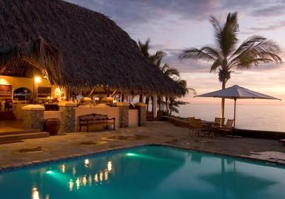 Bar and Pool at Sunset. Visit our website at www.raniresorts.com