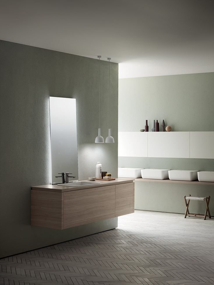 Ultimate comfort and optimal access to the wall unit compartment thanks to the vertical opening door, also equipped with a sophisticated mechanism that guarantees soft and silent closing