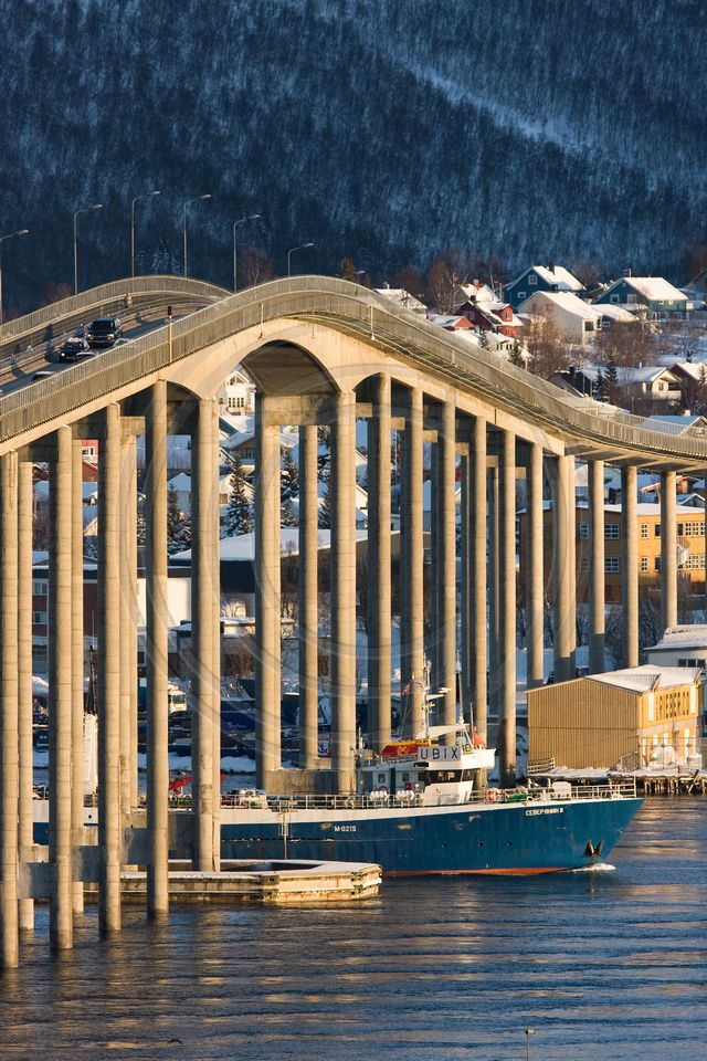 The Tromsø Bridge in Tromsø, Norway - The bridge crosses the Tromsøysundet strait. The 3,399 feet long bridge has 58 spans. It opened in 1960.