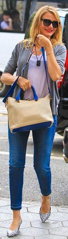 Who made Cameron Diaz's blue handbag and black sunglasses? Sunglasses – Saint Laurent Purse – Chloe