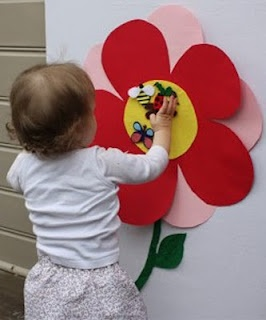 SINGING TIME IDEA: Would work well for Nursery...Pin the insect on the flower