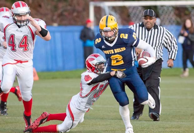 South Delta Sun Devils David Mann breaks away from John Barsby defenders on his way to a 77-yard touchdown in his team's 27-12 provincial semi-final victory on Saturday at UBC Thunderbird Stadium.