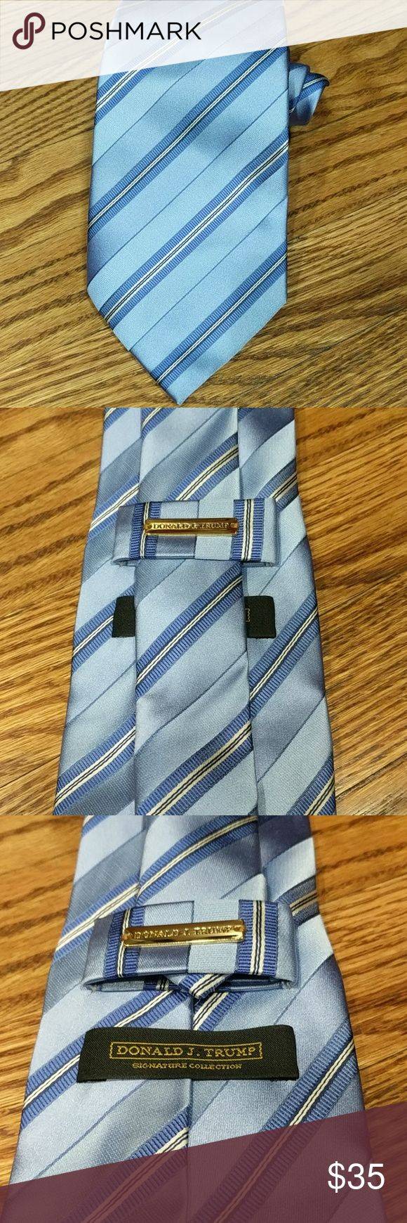"""Donald Trump Signature Collection Men's tie Donald Trump's Signature Collection Men's blue striped power tie. Stripes run diagonally, with a thin white and black stripes within. Hand made in China, 100% silk. Approximately 58"""" long and 4"""" at the widest part.   🌟Smoke free home 🌟No trades 🌟111 Donald Trump Accessories Ties"""