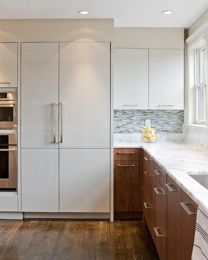 white kitchen cabinets on top and wood on bottom = another option | contemporary kitchen by Venegas and Company