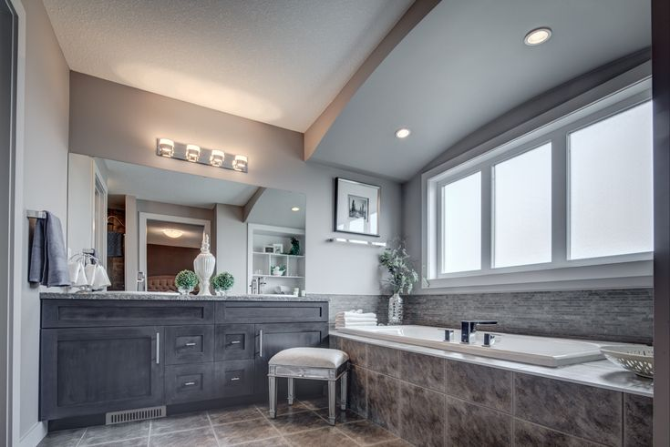 Love the large window over the bathtub  http://blog.yourpacesetter.com/blog/bid/335496/New-Show-Home-The-Kristana-in-Crystallina