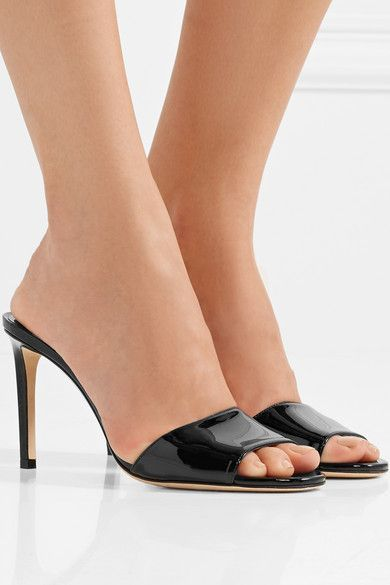 214320eb8a9 Simple black mules are just as essential as a pair of pumps ...