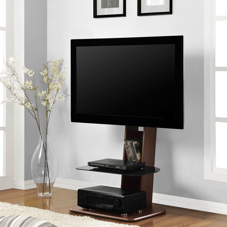 "Get the skinny on this space-saving TV stand featuring a streamlined design and sleek glass shelf. It holds up to a 50"" flat screen, hides all your cords down the back panel, and it still has room to store DVDs and components."