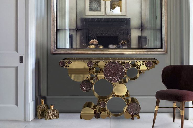 Wanderlust Console - On #Wanderlust #console, a variety of widths of the #polished #brass pipes carries the same artificial yet natural #landscape into #interior #spaces. The yellow tinted transparent glass top gives a #unique #style and #sophisticated #elegance to this #wonderful #piece.