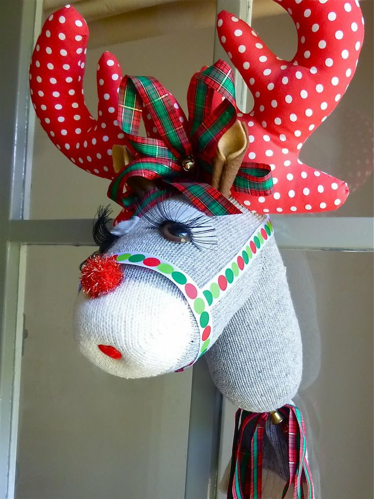 diy sock reindeer...attach it to a stick for the grandkids to ride at christmas time