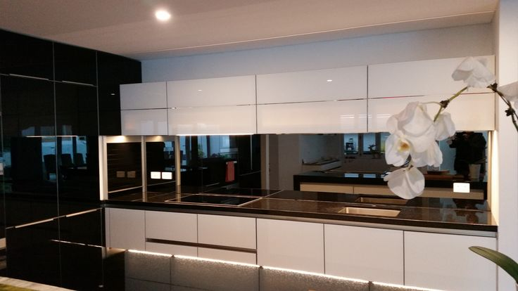This is one of best selling mirrored glass splashbacks called reflections which gives this Perth kitchen the Wow factor. Follow us of our Facebook page !