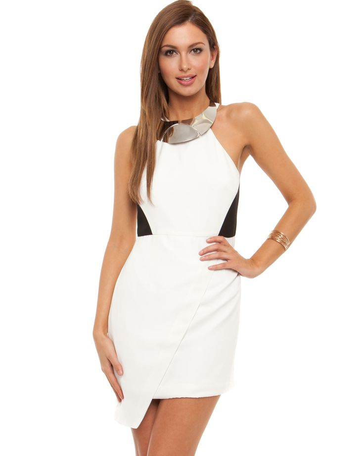 Wrap-style mini dress. The Seduce The Score Dresshas a high neckline, a sleeveless, racer-cut design, and a single button fastening on the nape of the neckline with a keyhole cut-out. Embellished with a silver-toned metal plate on the neckline, the dress features black side panels on the bodice, and a stark white main. TheSeduce The Score Dress has an asymmetrical, wrap-style skirt, an invisible zip closure on the back, and a full lining.Our model is wearing a size 10 dress, a…