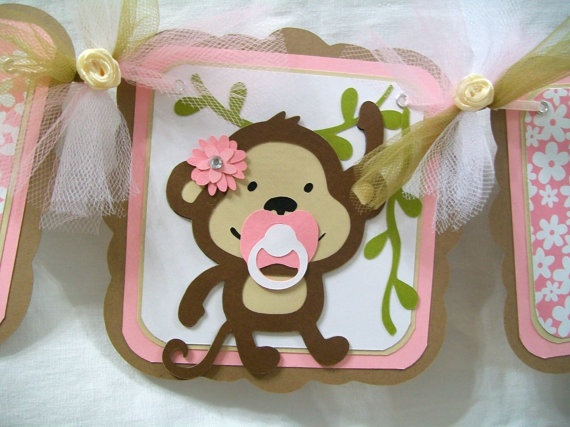 monkey baby shower banner. it's a girl, in pink and brown...